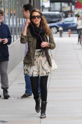 jessica_alba_pink_headphones_black_leggings_black_boots_pattern_skirt_green_jacket_sunglasses